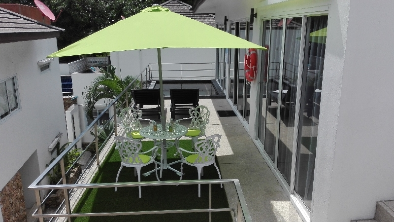 Villa PARIS, with garden furniture, parasol, and swimming pool on the terrace   pleasant relaxation